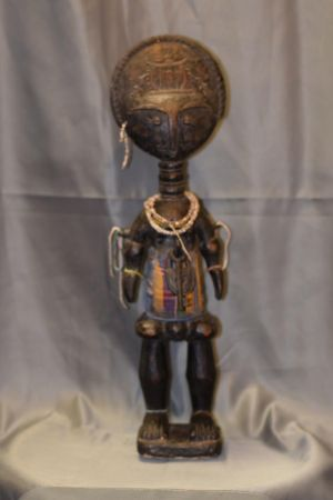 Old Akuaba doll. Ashanti fertility doll, Ghana. Made from wood, Kente fabric and old trade beads.